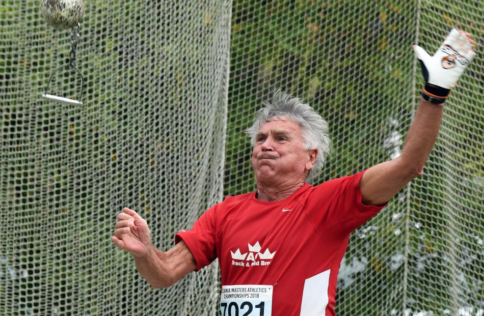 Ivan Sobotka, of the Czech Republic, gives his all at the weight throw.