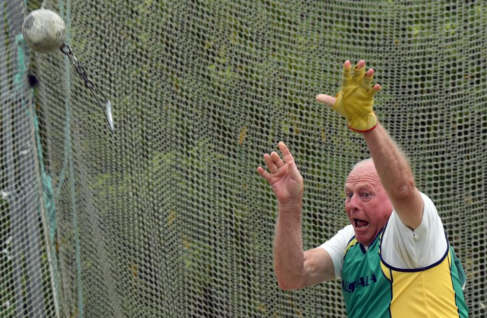 Peter Young, of Australia, releases the weight.