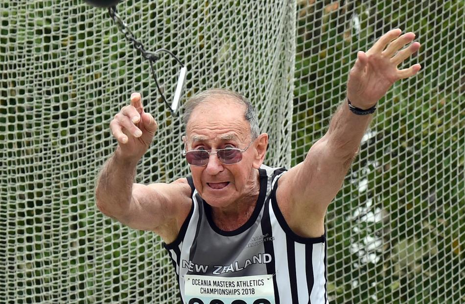 Peter Tearle, of New Zealand, throws at the Oceania Masters Athletics Championships yesterday.