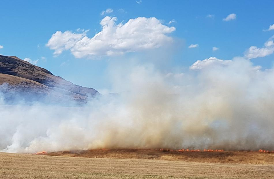 A grass fire blazes yesterday afternoon near Jacks Point, Queenstown. Photo: Alister Brown