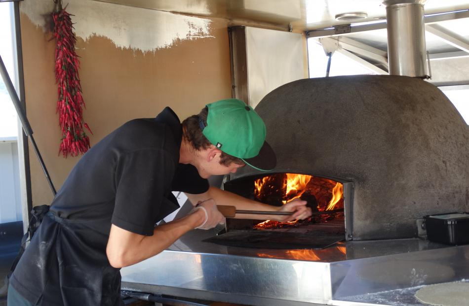 Pizza chef Jamie Suddaby of Francesca's Pizzas in Wanaka was working in front of a 400degC oven yesterday afternoon. Photo: Sean Nugent