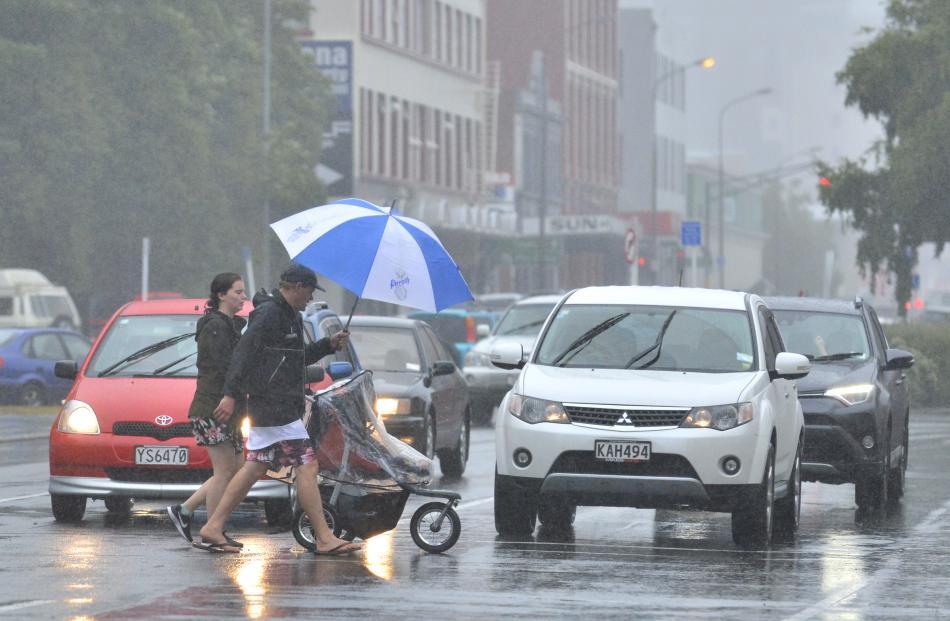 Pedestrians brave the rain in Cumberland St. Photo: Gerard O'Brien