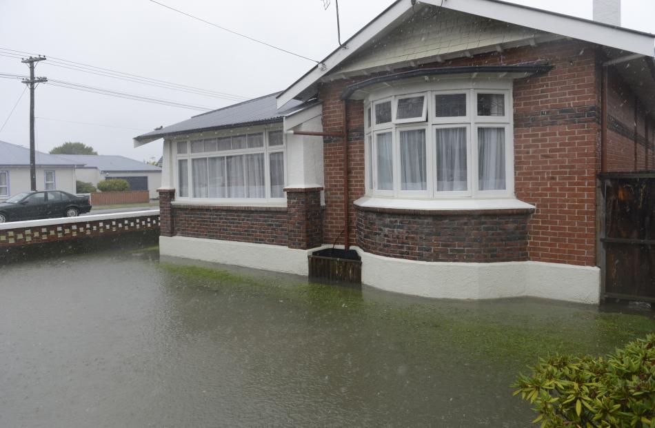 Flood water creeps into a Macandrew Rd property. Photo: Gerard O'Brien