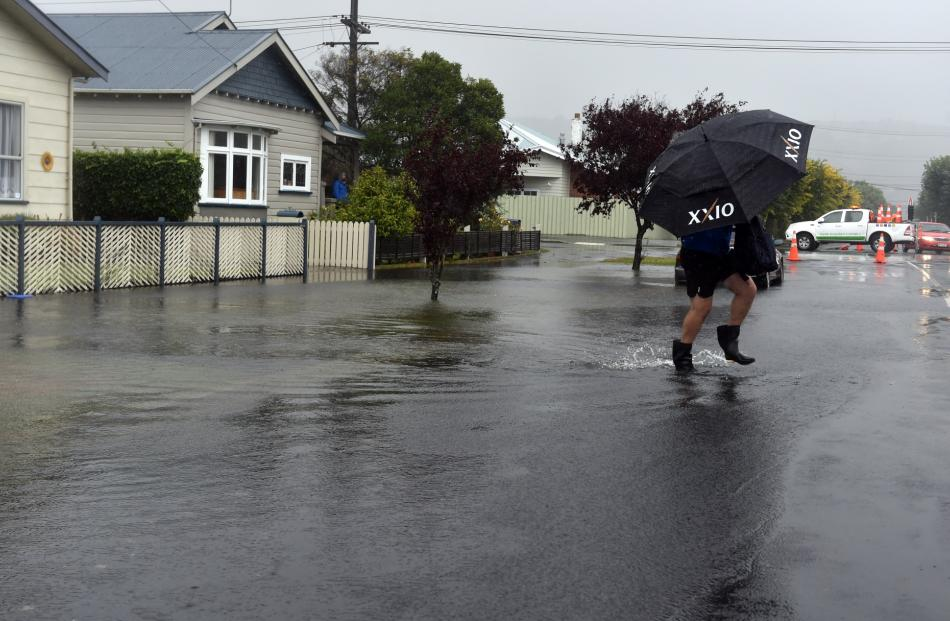Water spills on to the footpath on a St Clair street. Photo: Peter McIntosh