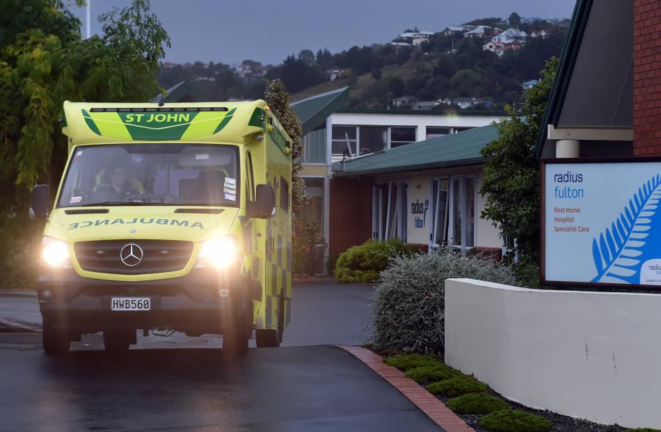 An ambulance moves patients from Radius Fulton Rest Home last night.