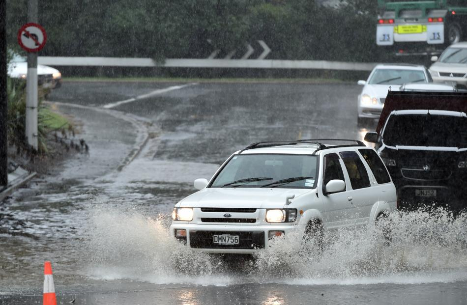 Main South Rd, flooded beneath the motorway overbridge at Concord yesterday. Photo: Peter McIntosh