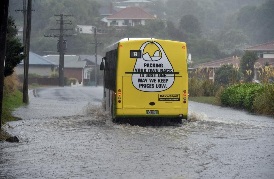 A bus negotiates a flooded Marne St yesterday. Photo: Gregor Richardson