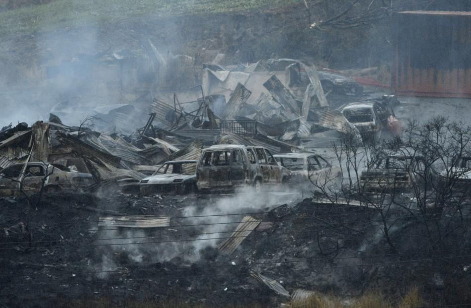 Area A - Cars, some in the process of being restored, were destroyed in the fire. Photo: Gerard O...