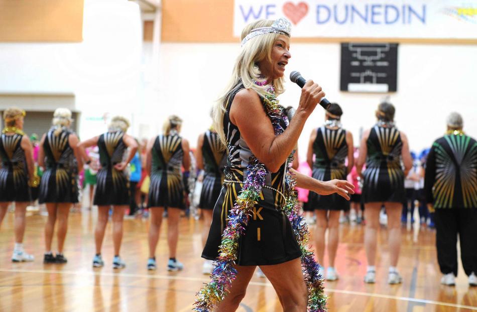 Sharon Butterworth eggs on her Koaki team, from Waikato and  Australia, in Hollywood dress,...