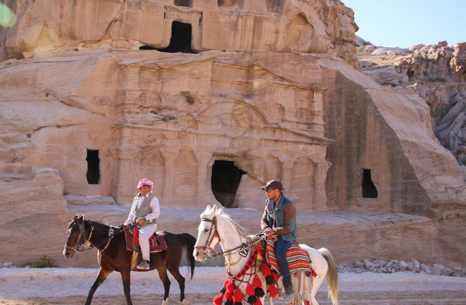 Horsemen, shown here passing the Obelisk Tomb, will bring visitors a short distance to the...