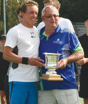 Ian Willans of  Te Anau (at right) presented winner Rubin Statham with the Willans Family Trophy.