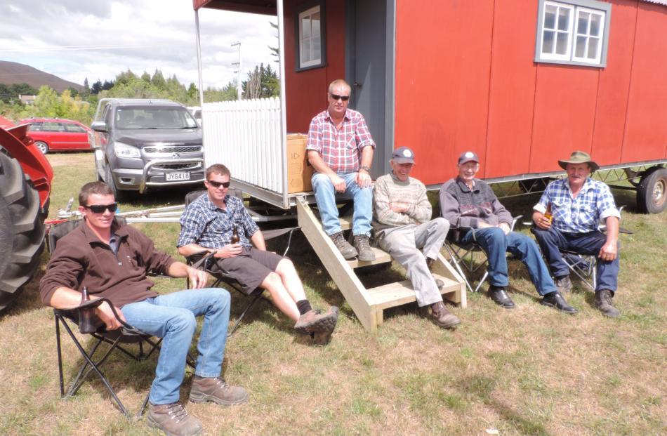 East Otago Vintage Machinery Club members (from left) Daniel Sheat, Gerard Sheat, Les Sheat,...