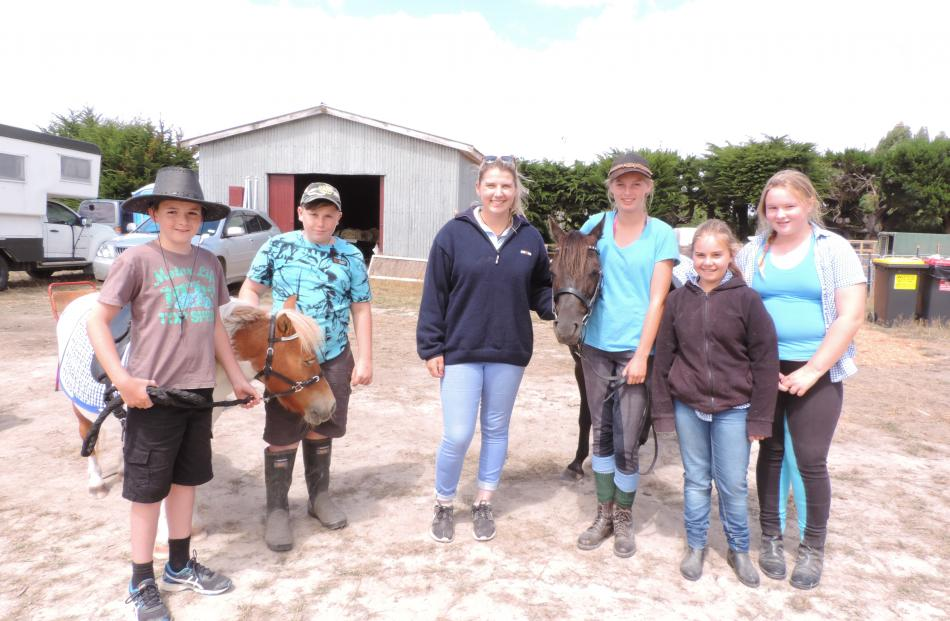 Helping to give pony rides with Herbert Forest horse enterprise Sanctum Grove Equine are (from...