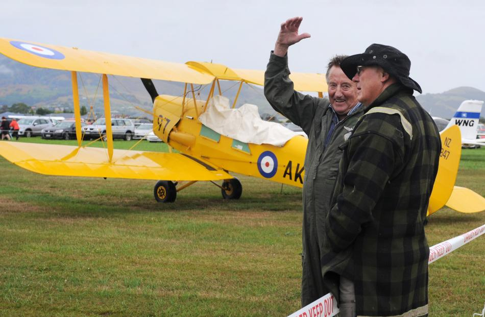 Pilot John Penno (left) explains the intricacies of a Tiger Moth to Bob Hayde at the Taieri Wings and Wheels Spectacular in Mosgiel on Sunday. Photos: Christine O'Connor