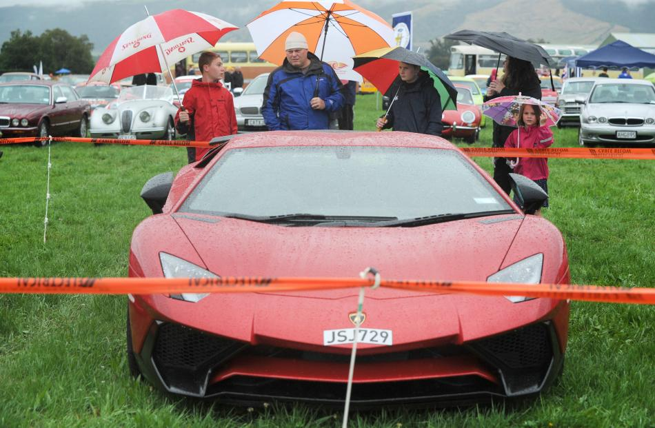 Mosgiel family (from left) Thomas (14), Justin, Luca (12) and Amaya (7) Farquhar admire a Lamborghini.