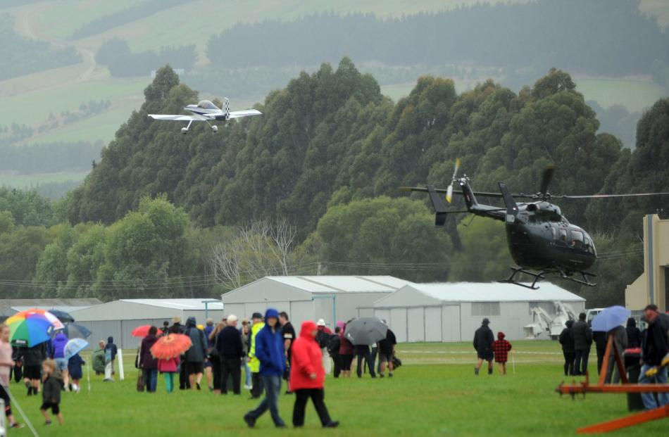 Aircraft travel overhead of spectators at the Taieri Wings and Wheels Spectacular in Mosgiel on Sunday.