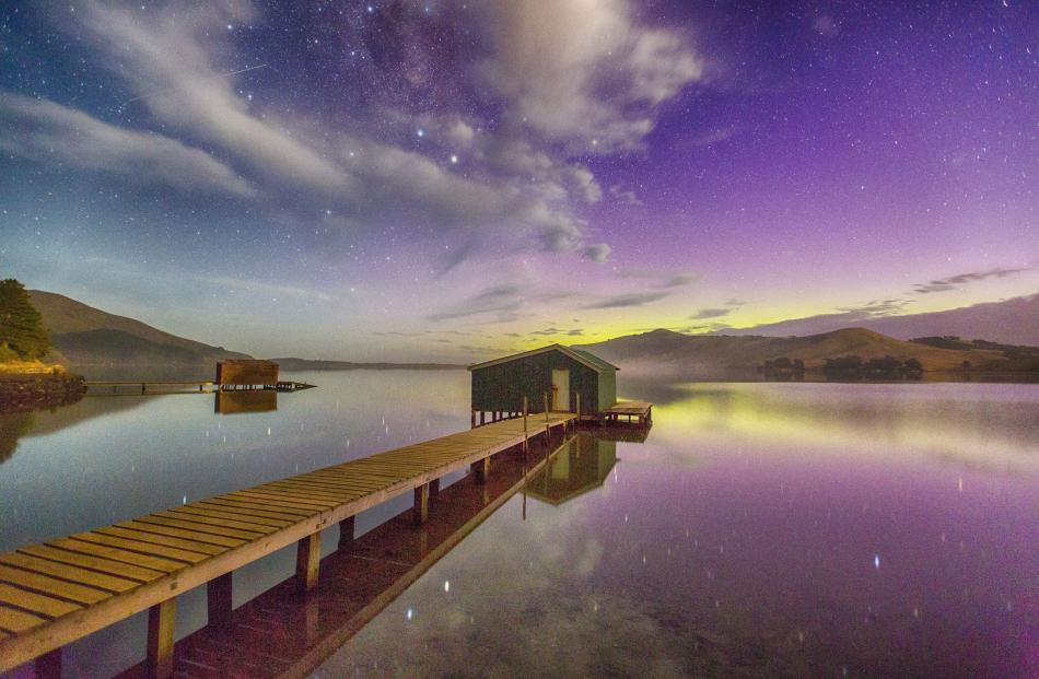 The Hoopers Inlet boat shed features in this image of Aurora Australis. Photo: Ian Griffin