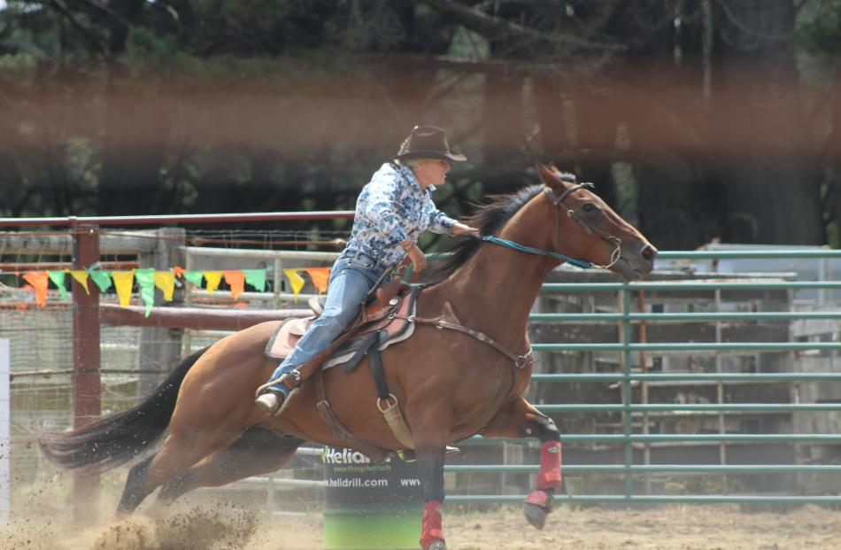Brooke Elstob, of Wanaka, on her way to second place in the second division barrel race.