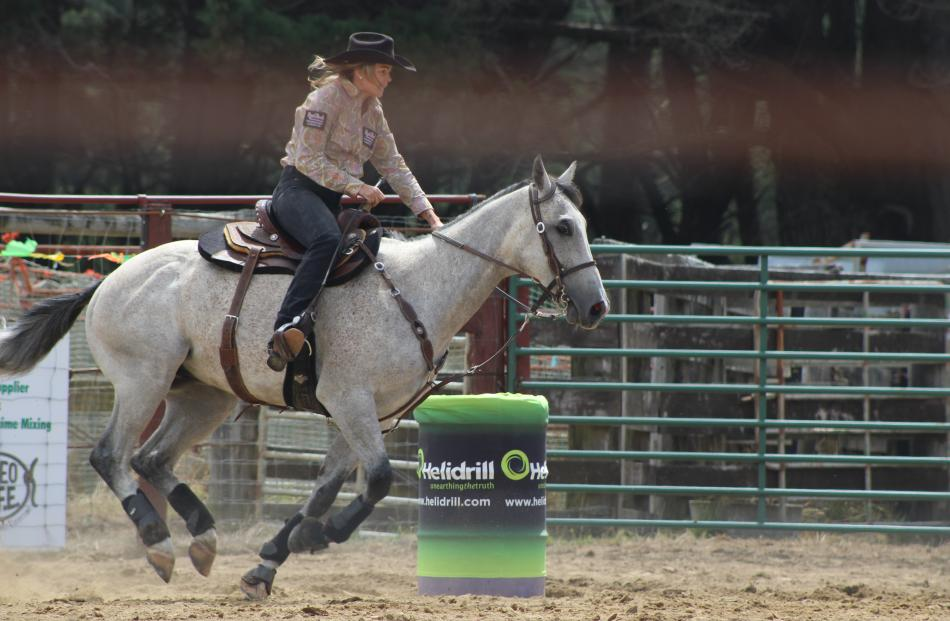 Tammy Wright, of Peel Forest, heads round a barrel during the second division barrel race.
