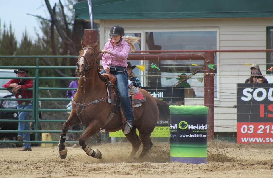 Casey Elstob, of Wairio, speeds up on the home straight during the open barrel race.
