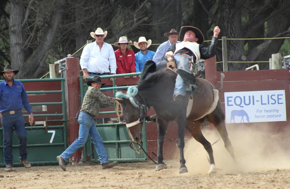 Ross Dowling, of Havelock North, sits back and holds on in his open bareback ride at the Southland Rodeo.