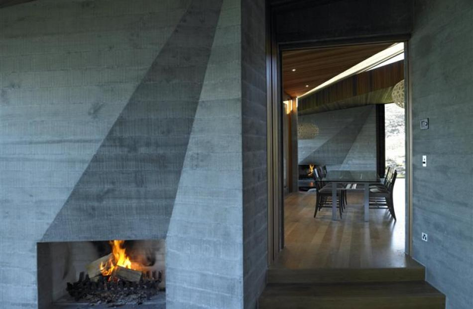 Twin sculptural fires anchor the main living space.