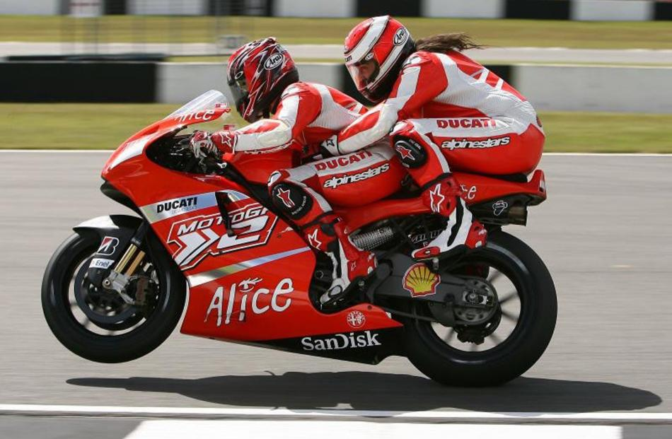 Randy Mamola takes a pillion on a fast lap of Donington Park in England. Photo: Riders for Health