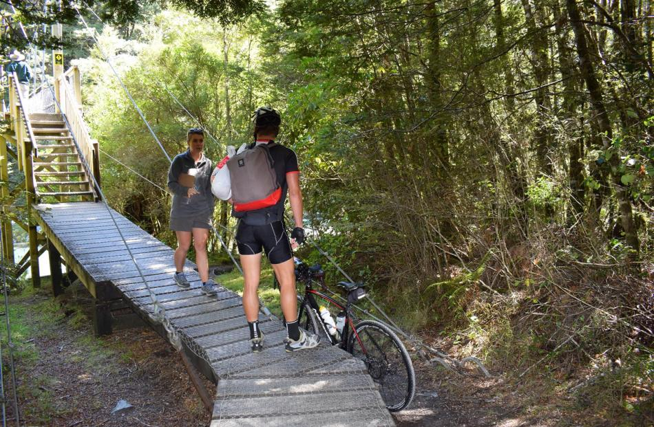 Doc ranger Yasmin Smith reminds a cyclist the track is only for walkers  and to walk the bike back out to the road.