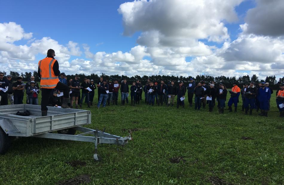 Farmers listen to a presentation from Lincoln University Faculty of Agriculture and Life Sciences dean Prof Grant Edwards about the use of ecotain in a paddock at the university's Ashley Dene Research and Development Station last month. Photos: David Hill