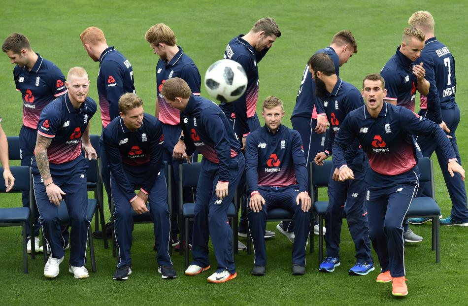 Members of the England cricket team disperse after a group photo at the University Oval yesterday. Photo: Peter McIntosh
