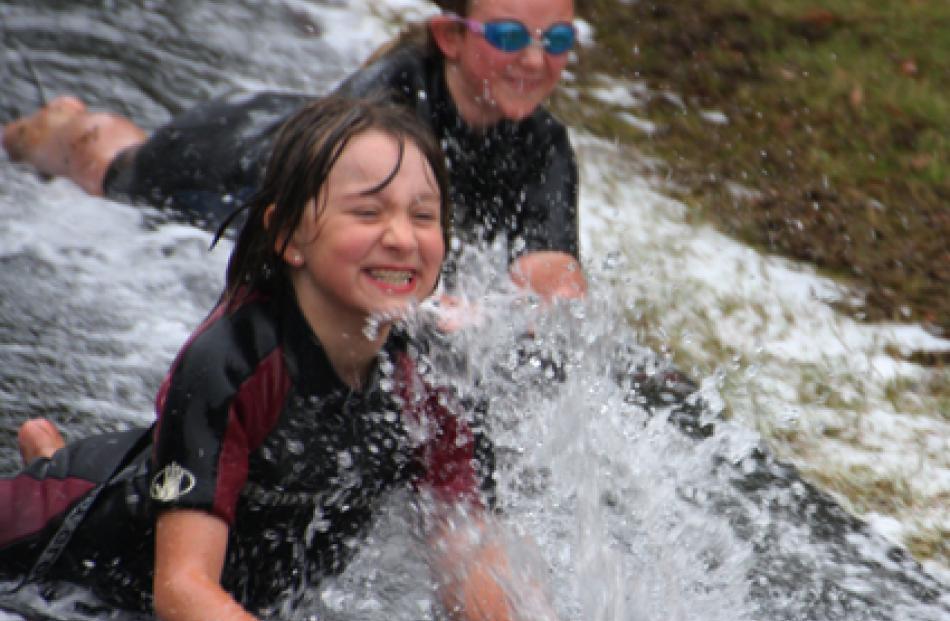 Scouts Te Anau Cub Ruby Hefford (left) and friend Lucy Christie, enjoying the mudslide.
