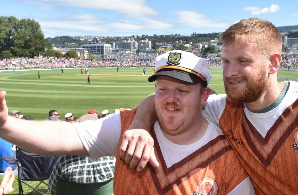 Glen Fitzgerald (left), of Invercargill, and Gareth Clarke, of Windsor, enjoy the action during England's innings.