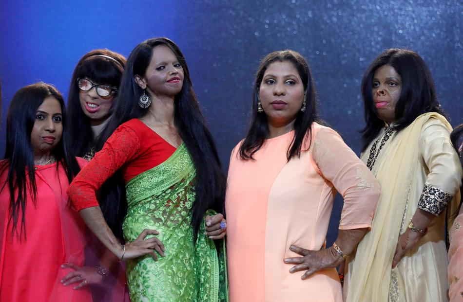Acid attack survivors pose during a fashion show to mark International Women's Day in Thane on...