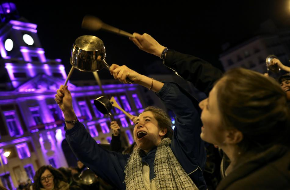In Spain, women bang pots and pans during a protest at the start of a nationwide feminist strike...
