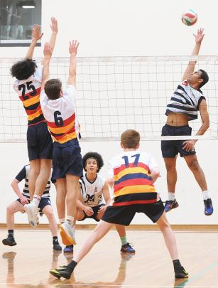 Henry Stowers (Otago Boys' High School) reaches high for the ball while team-mate Noah Rooney (centre) looks on. Lining up to defend are John McGlashan College players (from left) Mason Calvert, Will Turner and Adrian Crampton.