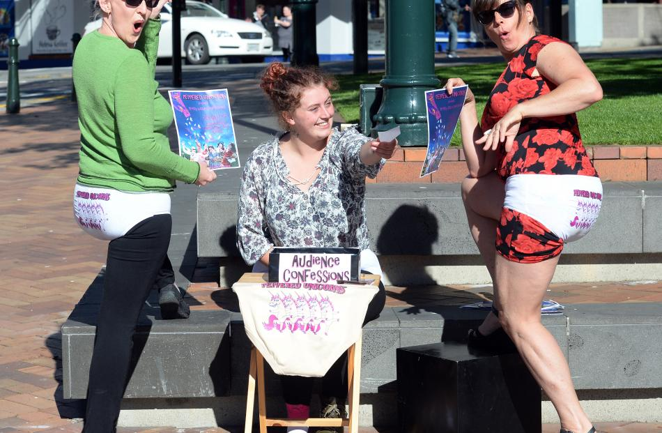Peppered Unicorn members Jo Ghastly(left), Georgie Sivier and Debbie Klausen, all of Christchurch, advertise their show in the Octagon yesterday.