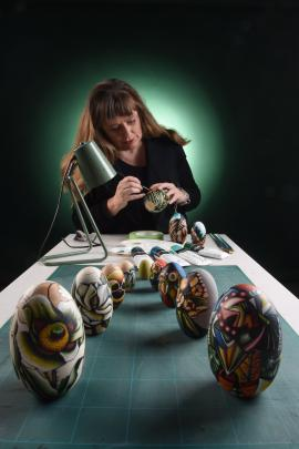 Kezia Fields spends hours painstakingly creating the designs on blank nesting dolls. Photos: Supplied