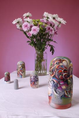 Flowers are a popular theme for Kezia Fields to paint on nesting dolls.
