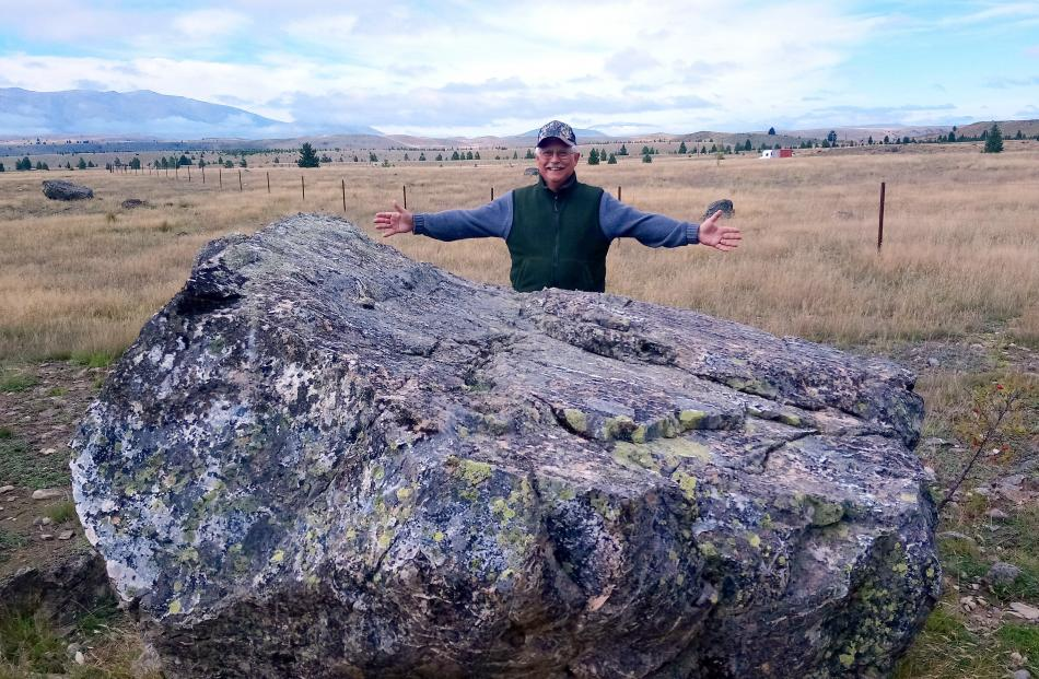 Al Mangine with the giant rock on which will stand a statue of a merino ram at the Merino Downs...