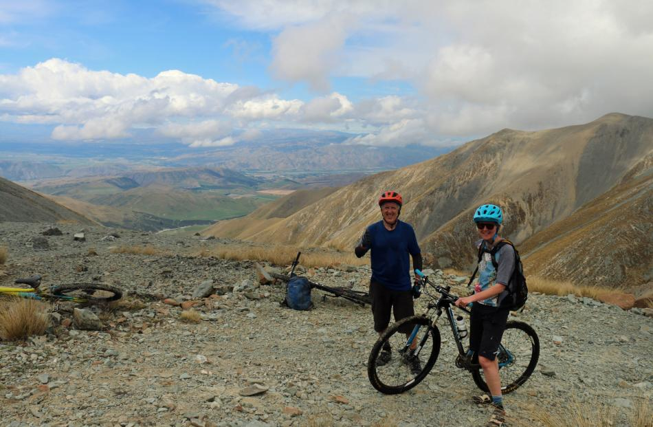 The writer and Dunedin mountain biker Sara Richardson stop to admire the view of the Hakataramea...