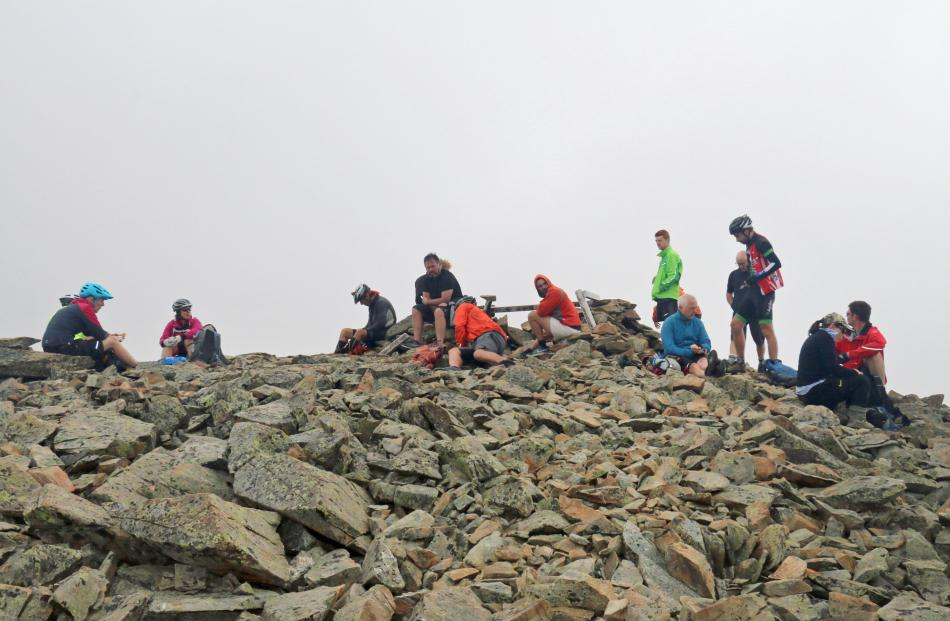 Riders have lunch at the summit Mt Kohurau.