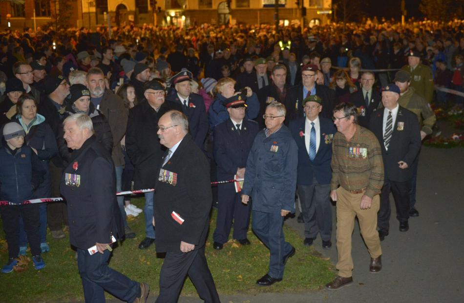 Veterans march onto Queens Gardens at the commencement of this morning's dawn service in Dunedin....