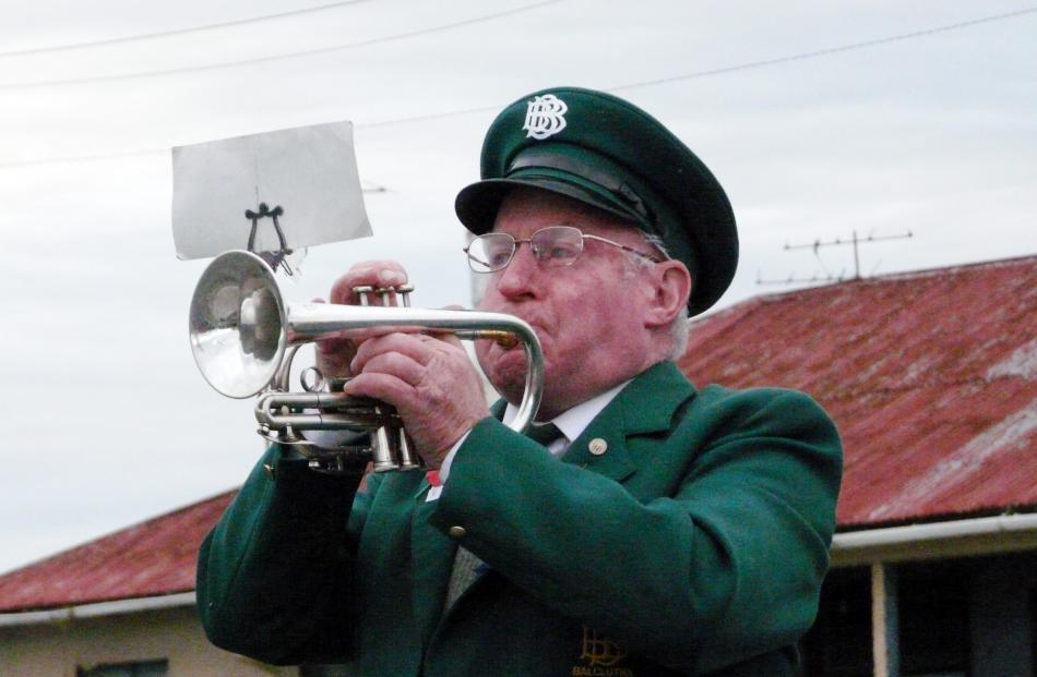 Balclutha Brass Band bugler Warrick Thomson plays the Last Post at the dawn service in Balclutha....