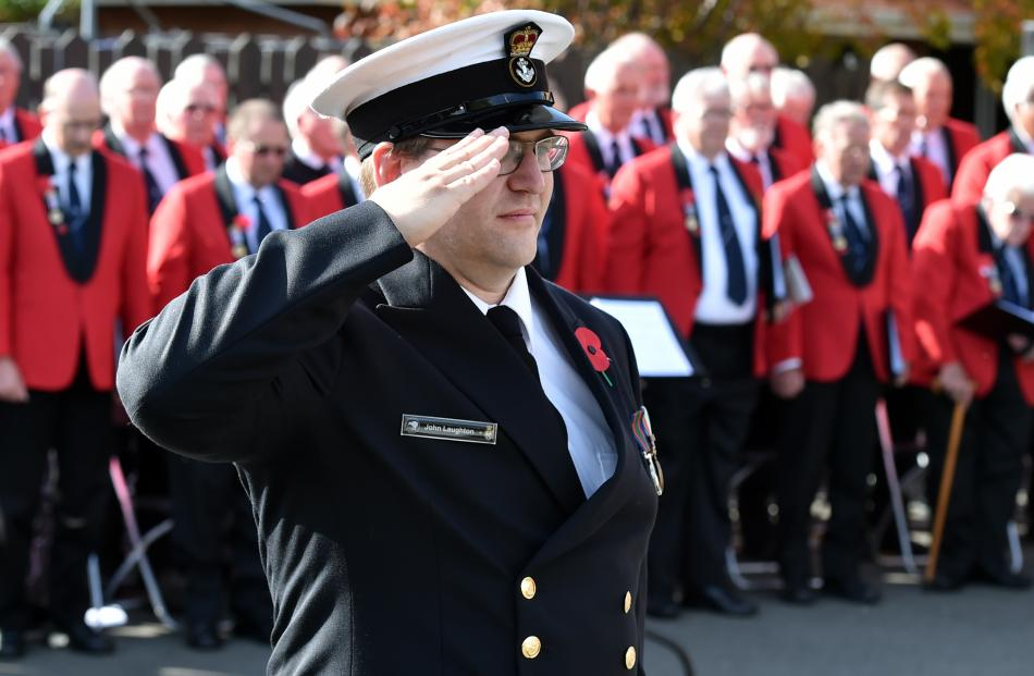 John Laughton, of HMNZS Toroa, salutes during the New Zealand national anthem at the Montecillo...