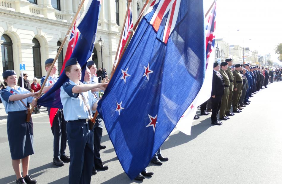 Members of Oamaru 26 Squadron of the Air Training Corps fly flags during a parade from the town's...
