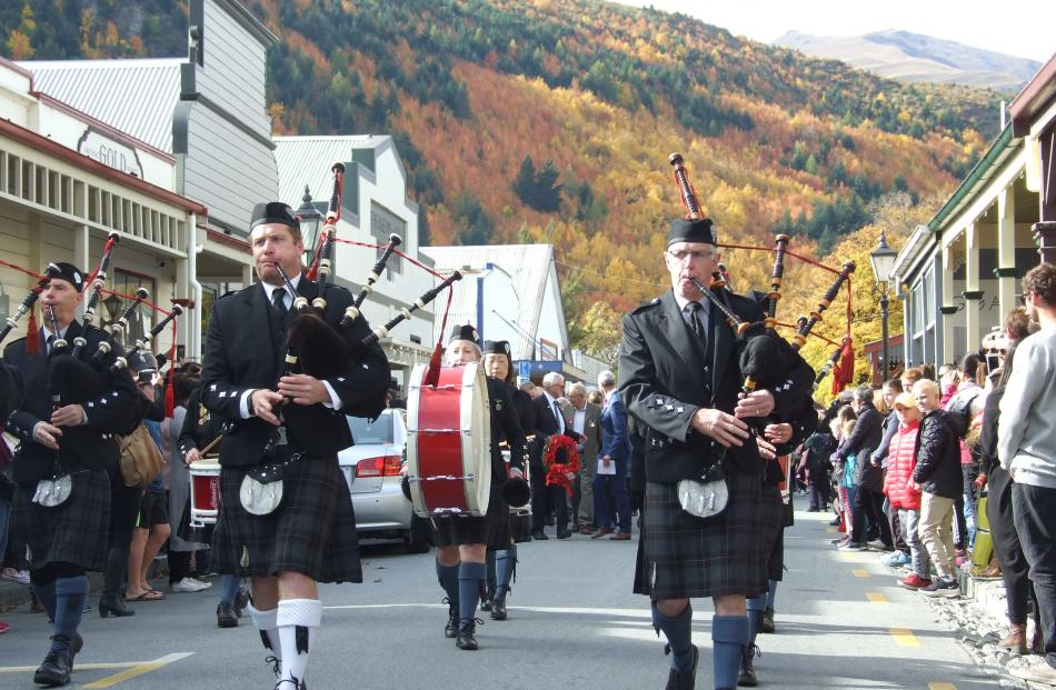 The Queenstown and Southern Lakes Highland Pipe Band leads a parade from the Arrowtown Athenaeum...