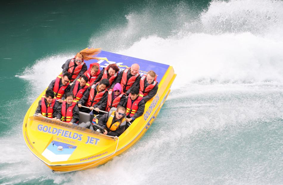 Rebecca Nadge (back left) makes the most of an adrenaline-fuelled jet-boat ride up the Kawarau...