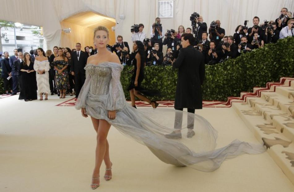 'Riverdale' actress Lili Reinhart took the heavenly theme literally with a flowing silver dress. Photo: Reuters