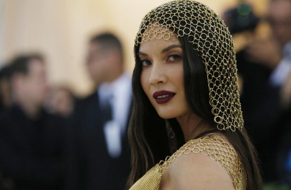Olivia Munn's outfit featured a chain-mail headdress. Photo: Reuters