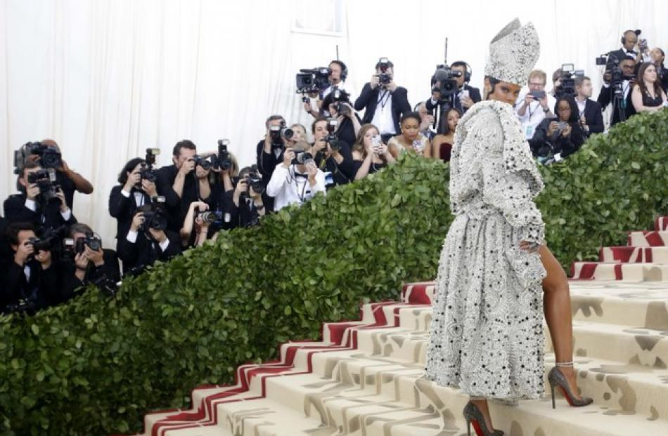 Rihanna, one of the Met Gala co-hosts, dressed like a pope, sporting a head-turning, jewel-encrusted mitre with matching mini-dress and a priestly-style cape designed by Maison Margiela. Photo: Reuters